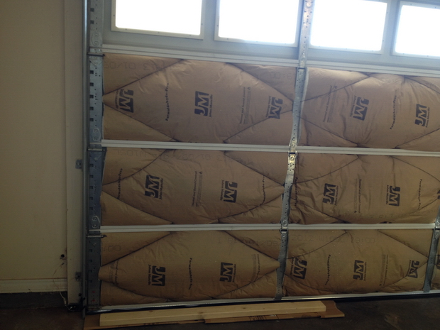 How do you keep your shop warm during winter-insulated-door.jpg